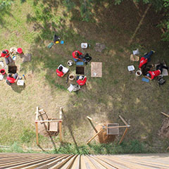 Colour photograph of an aerial view of the team during an archeological survey.